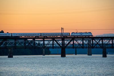 Northeast Regional at sunset through Have de Grace, MD, Susquehanna River