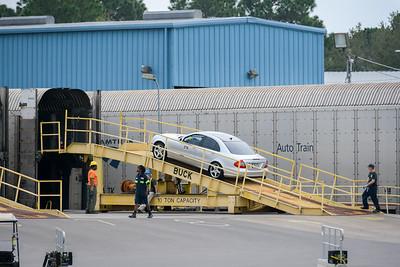 A Mercedes sedan is loaded onto Auto Train in Sanford, FL.