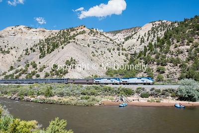 Train 5, the California Zephyr, passes boaters along the Colorado River near Dotsero.