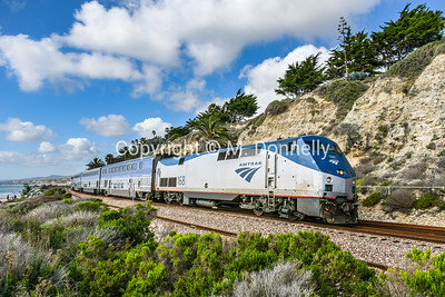 168 leads a Pacific Surfliner southbound through San Onofre.