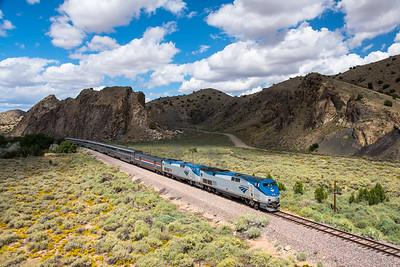Southwest Chief, Train 4, at Los Cerillos passing Devil's Throne.