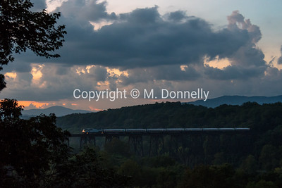 Northeast Regional train 147 rolls over the James River just outside of Lynchburg, VA at sunset on a steamy and humid evening.