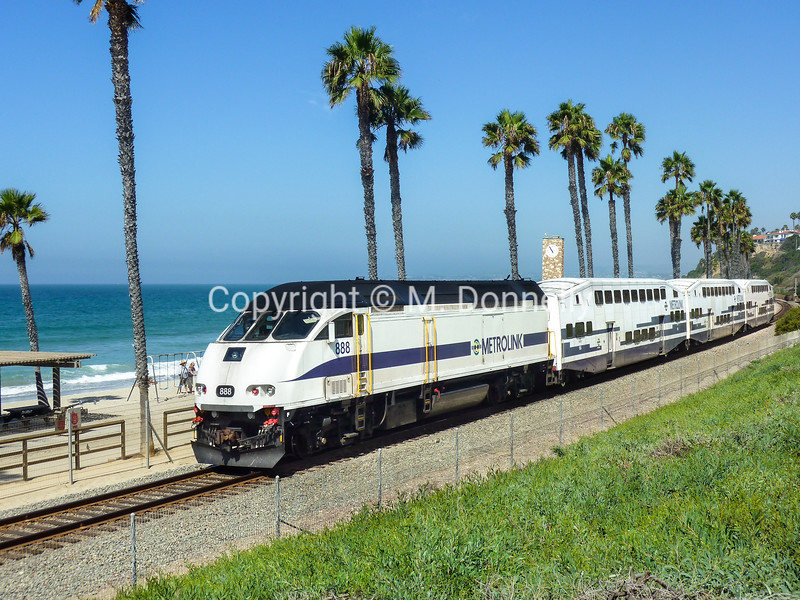Metrolink heads northbound through San Clemente Pier on a picture perfect morning. Licensed to Shift5 Inc.