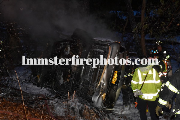 MELVILLE FD CHIEF MAKES GRAB FROM BURNING MVA NSPKWY 3012-18