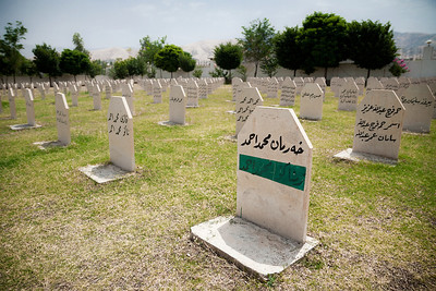 This grave in the Halabja Cemetery has one of its names covered in verdant green to mark a survivor who was originally thought to have been killed. The man, who was a child at the time of the attack, was rescued by a group of Iranians.   Iranians, whose country was in fighting in the closing days of its war with Saddam, were many of the first responders to the attack, as well as the first journalists to cover it when they crossed over the border near Halabja. The survivor was raised in Iran until his 18th birthday and then returned to his family which was overjoyed to see him.
