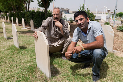 The caretaker of the Halabja Cemetery, along with my driver, which is for the victims of Saddam's 1988 poison gas attack. The attack claimed as many as 5,000 lives.