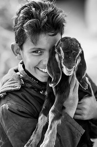 Aouwath, age 14,  with his goat, Wadi Rum, 2007.