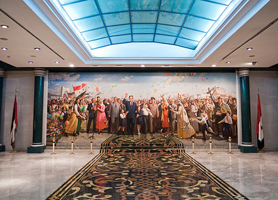 The mural of former Syrian president Hafez Al-Asad at the Syrian October War Panorama Museum. Here, he stands with Syrians dressed in traditional clothing, each one representing a different governorate of Syria or role in its society.