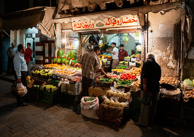 Shopping for fruits and vegetables at the Souq Bab As-Srijai market just outside of the Old City.