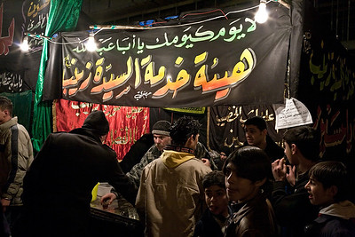 A sabeel, or refreshment stand, set-up for pilgrims in Sayyidah Zaynab during Moharram.