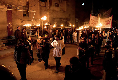 An Iraqi procession carrying Misha'als on the streets outside Sayyidah Zaynab.