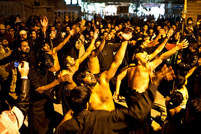 Pakistani Anjuman Shia pilgrims performing Matam (here, striking of the chest) outside the main gate of the Sayyidah Zaynab mosque.