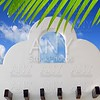 Mexican architecture white archs blue sky