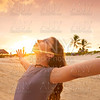 Open arms girl at sunset caribbean beach