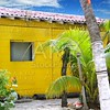 Caribbean tropical yellow beach wooden house