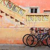 bicycles on grunge tropical Caribbean orange facade
