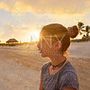 Girl at sunset caribbean beach in Mexico