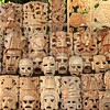 Mayan wood mask rows Mexico handcraft faces