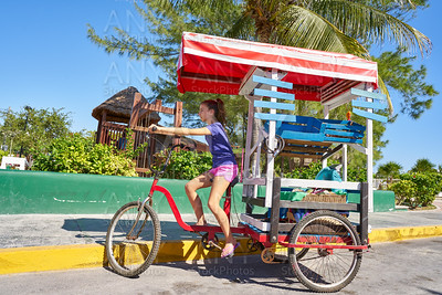Young girl with caribbean tricycle shop