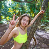 Caucasian girl playing victory sign in jungle