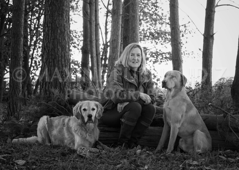 Daphne sat on log with dogs BLACK AND WHITE CONVERSION