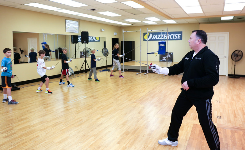 Marc Ganych teaches a group of students at the Jazzercise Studio in Canton