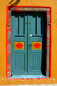 Awash with colour, a door on the island of Santorini, Greece.