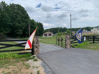 Fla. & USN flags at gate ...