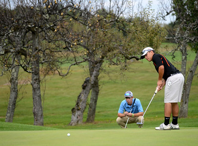 Tania Barricklo-Daily Freeman Marlboro's Cade Cabrera putts as Kieran Defino of Saugerties looks on.