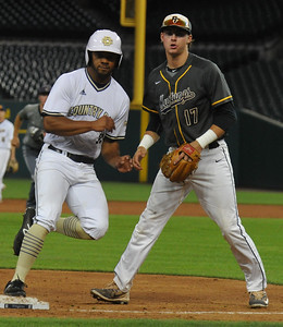 Detroit Tiger draftees Steve Mann (L) of Country Day and Jeff Criswell of Portage Central cross paths at third base during the MHSBCA All Star Game held on Tuesday June 20, 2017 at Comerica Park in Detroit.  Mann's East team defeated Criswell's West team 7-5.  (Digital First Media photo by Ken Swart)