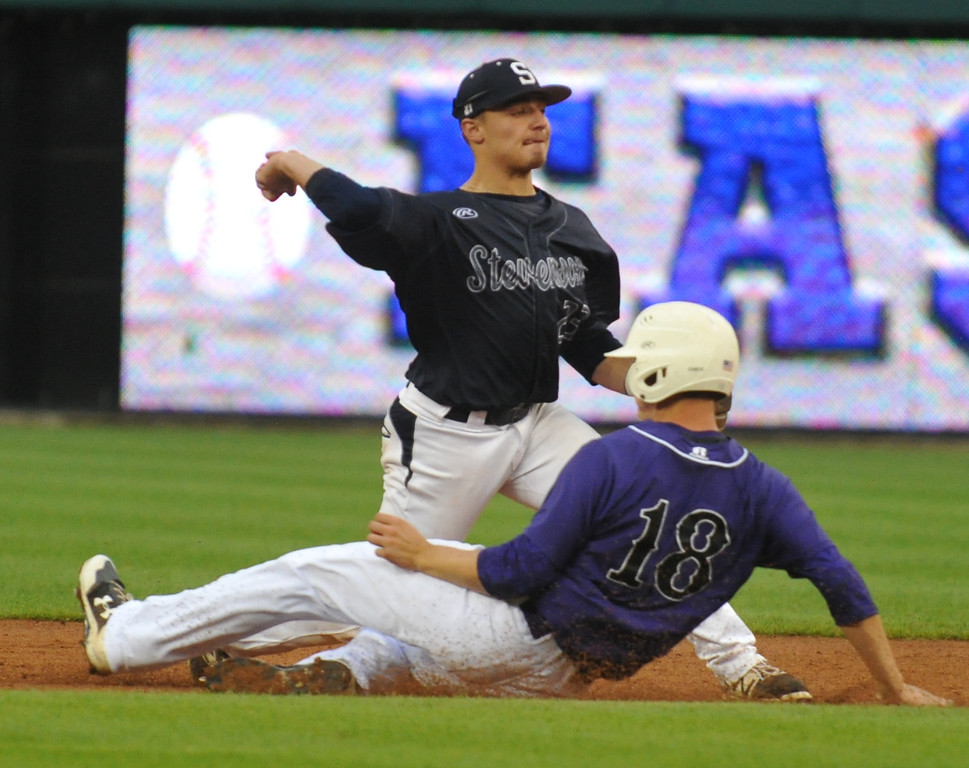 . Sterling Heights Stevenson\'s Mario Camilletti (23) turns a double play as Battle Creek Lakeview\'s Nate Jones (18) slides into second base during the 3rd inning of the MHSBCA All Star Game played on Tuesday June 20, 2017 at Comerica Park. The East squad won the game 7-5.  (Digital First Media photo by Ken Swart)