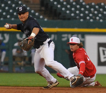 Sterling Heights Stevenson shortstop Mario Camilletti (L) makes a throw to 1st base as teammate Connor McCarron of University Liggett looks on during the MHSBCA All Star Game played on Tuesday June 20, 2017 at Comerica Park. The East squad won the game 7-5.  (Digital First Media photo by Ken Swart)