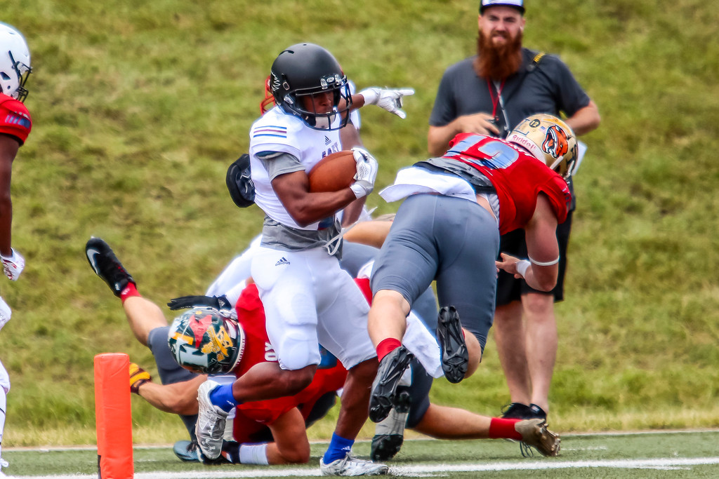 . The East squad struck early after a 51 yard connection on the opening play and held on to take a 21-0 victory over the West team on Saturday at Saginaw Valley State University. (Oakland Press photo by Timothy Arrick)