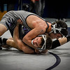 Shawsheen's Brian Caldwell trys to keep his shoulders up off the mat as he wrestles St. John Prep's Zach Alexander at the MIAA Division 1 North Sectional Tournament at Methuen High. SUN/Caley McGuane