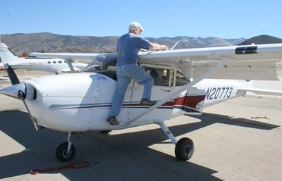 "Doing ""pre-flight"" of Cessna 172 SP at San Luis Obispo airport"