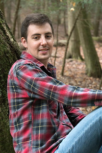 LEANING ON TREE PORTRAIT RED SHIRT