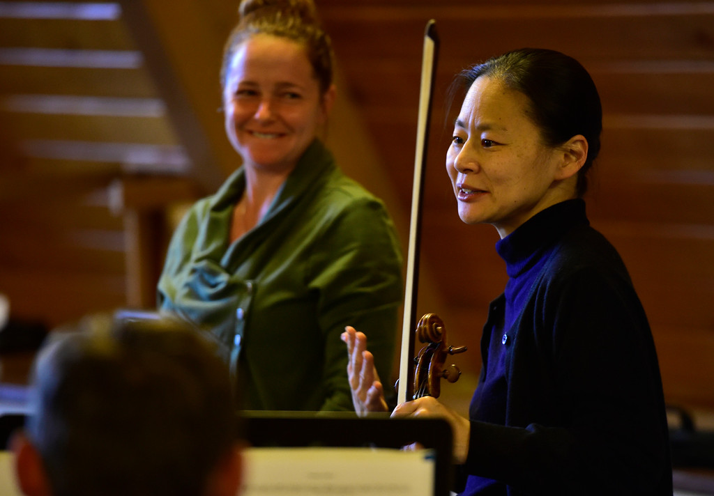 . BOULDER, CO - OCTOBER 31, 2018 Midori talks with the Boulder Youth Orchestras\' Wind Ensemble during practice at the Mountain View United Methodist Church in Boulder on Wednesday October 31, 2018. Stephanie Texera, in the background, was conducting the ensemble.  (Photo by Paul Aiken/Staff Photographer)