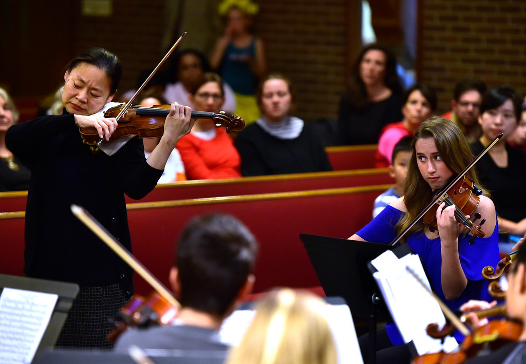 . BOULDER, CO - OCTOBER 31, 2018  Violinist Midori plays with the Greater Boulder Youth Orchestras and Concert Mistress Lucy Rissman, at right, during practice at the Mountain View United Methodist Church in Boulder on Wednesday October 31, 2018.  (Photo by Paul Aiken/Staff Photographer)