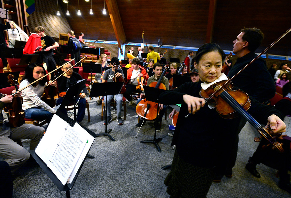 . BOULDER, CO - OCTOBER 31, 2018  Violinist Midori plays with the Greater Boulder Youth Orchestras as Gary Lewis prepares to conduct during practice at the Mountain View United Methodist Church in Boulder on Wednesday October 31, 2018.  (Photo by Paul Aiken/Staff Photographer)
