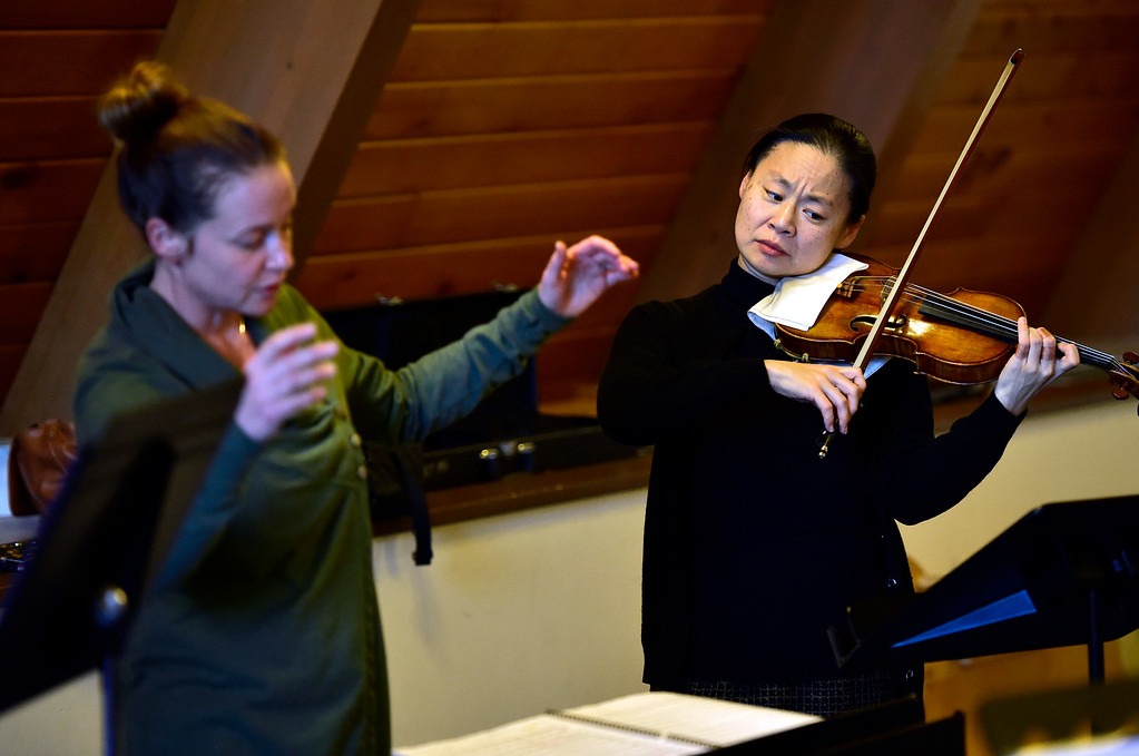 . BOULDER, CO - OCTOBER 31, 2018 Midori plays with the Boulder Youth Orchestras\' Wind Ensemble during practice at the Mountain View United Methodist Church in Boulder on Wednesday October 31, 2018. Stephanie Texera, at left, was conducting the ensemble.  (Photo by Paul Aiken/Staff Photographer)