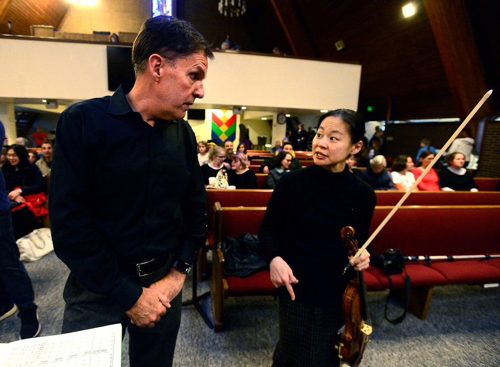 . BOULDER, CO - OCTOBER 31, 2018  Violinist Midori talks with the Greater Boulder Youth Orchestras\' Conductor Gary Lewis during practice at the Mountain View United Methodist Church in Boulder on Wednesday October 31, 2018.  (Photo by Paul Aiken/Staff Photographer)