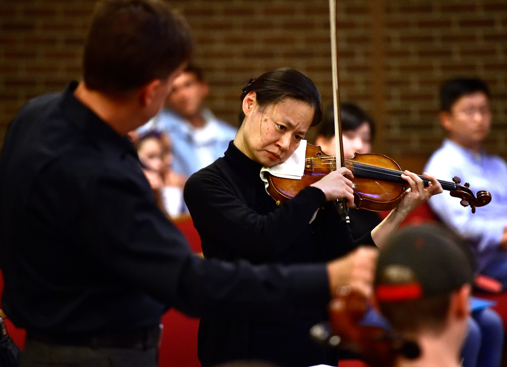 . BOULDER, CO - OCTOBER 31, 2018  Violinist Midori plays with the Greater Boulder Youth Orchestras as Gary Lewis conducts during practice at the Mountain View United Methodist Church in Boulder on Wednesday October 31, 2018.  (Photo by Paul Aiken/Staff Photographer)
