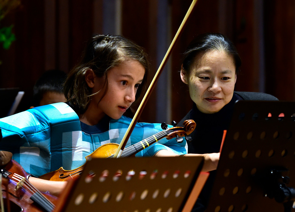 . BOULDER, CO - OCTOBER 31, 2018  Midori plays with the Greater Boulder Youth Orchestras and Dylan Chimoskey during practice at the Mountain View United Methodist Church in Boulder on Wednesday October 31, 2018.  (Photo by Paul Aiken/Staff Photographer)