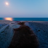 Moonlit beach at Silver Sands State Park, Milford, CT, USA.