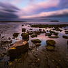 Long exposure image taken during low tide on a beautiful evening at Silver Sands Beach,  Milford, Connecticut, USA.