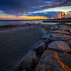 Sunset by the breakwater at Gulf Beach, Milford, CT, USA.