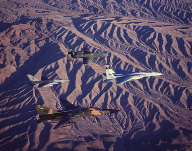 F-15 Eagle, A-10 Warthog, F-16 Fighting Falcon & F-111 AArdvark over Desert near Nellis AFB, Nevada