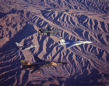 F-15 Eagle, A-10 Warthog, F-16 Fighting Falcon & F-111 AArdvark over Desert near Nellis AFB, Nevada