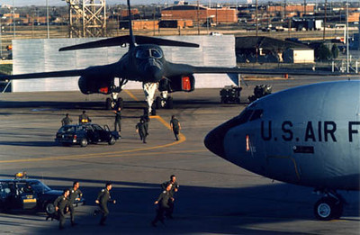 Aircrews scramble to their B-1B and KC-135 as part of a test of the National Defense System.