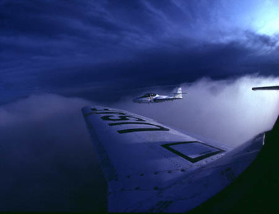 T-37 from Randolph AFB, Texas skirts the cloud decks as we approach twilight while coming back from a training mission.